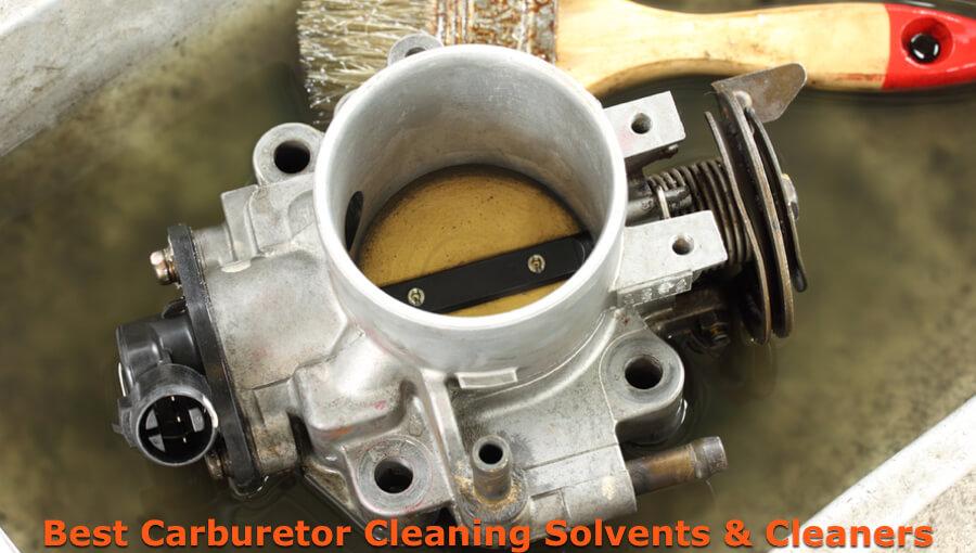 Cleaning carburetor in the bucket.
