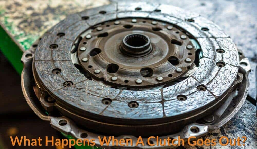 A wearing out clutch disc in the mechanic workshop.