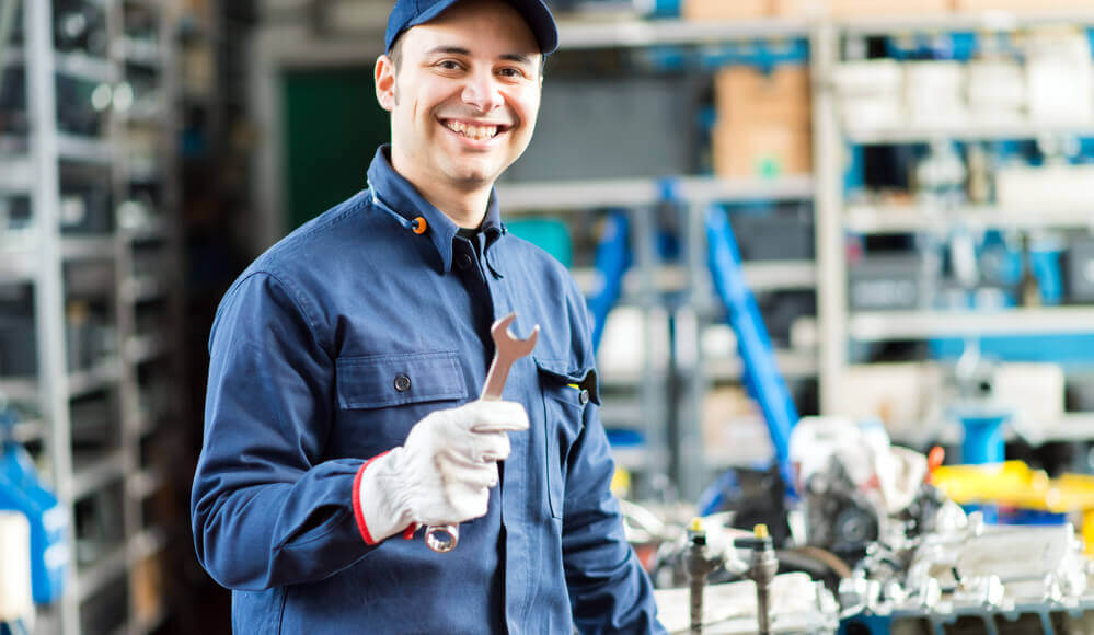 Mechanic repairing diesel engine.