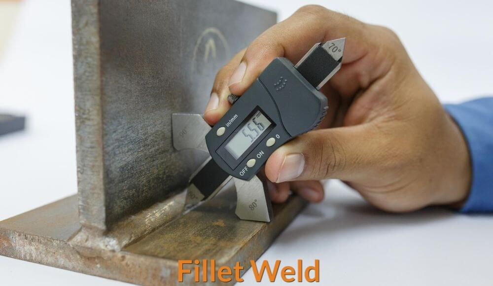 An Engineer is inspecting and measuring the accuracy of the fillet weld.