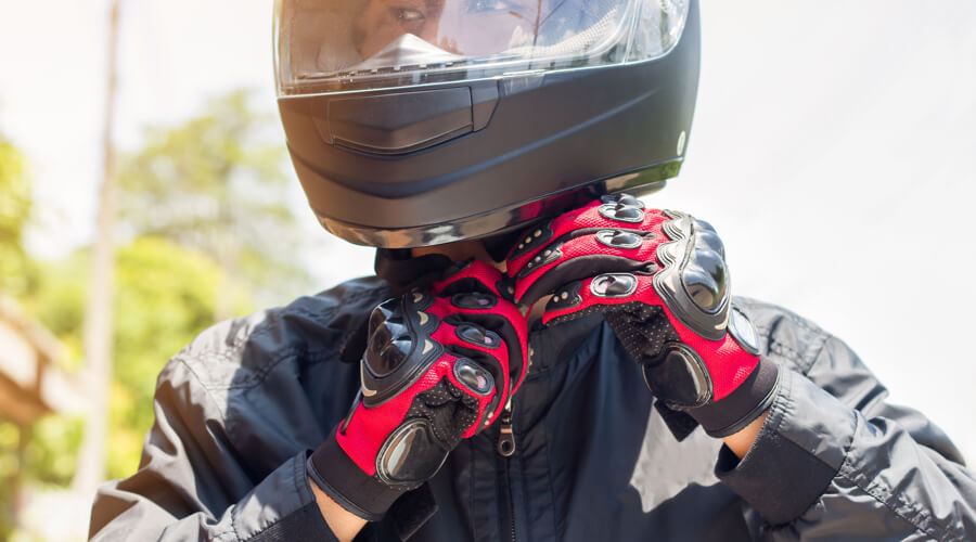 Motorcyclist wears quality helmet for safety.