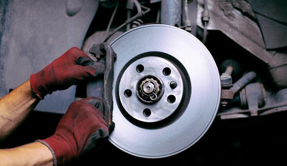 Car mechanic repair brake fade.