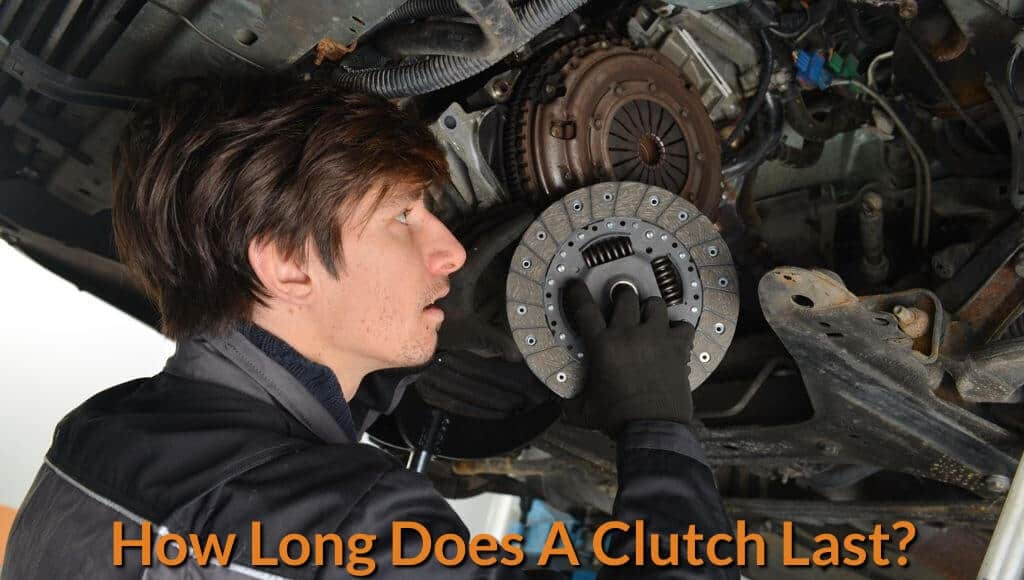 A mechanic is inspecting and replacing the clutch disc.