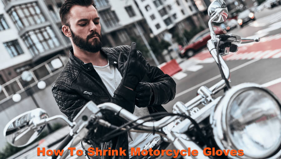 Motorcyclist adjusting his stretched leather gloves.